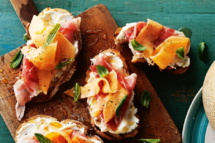 Rockmelon bruschetta with goat's cheese and prosciutto